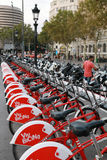 Red bicycles for rent on the Placa de Catalunya in Barcelona Stock Photos