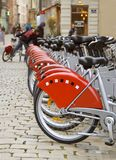 Red bicycles in town. Row of bicycles (partial view) enviromentaly save variant of city transportation Stock Image