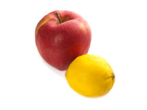 Red big apple and yellow lemon Stock Image