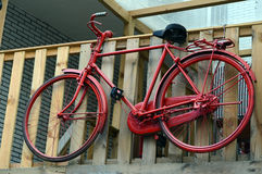 A red bike. As a sign of a village inn Royalty Free Stock Photo