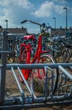 Red bike. In a bicycle parking rack Royalty Free Stock Photo