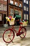 """Red Bike Flower Stand, GdaÅ""""sk, Poland. Flower stand made from old bike. Photo taken in Gdańsk, Poland stock photography"""