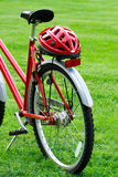 Red bike and a helmet Stock Images