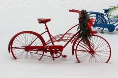 Red bike with holiday greenery Royalty Free Stock Images