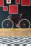 Red bike in spacious studio stock image