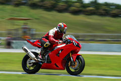 Red Bike on the Track. Red Bike Racing on the Track Royalty Free Stock Photo