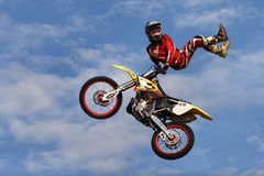 Red biker. Biker jumping on his bike Stock Photo