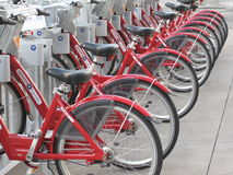 Red bikes. Rows of red bikes that are used for rentals to to get around Denver are both useful for fun and exercise but also good for the environment as it saves Stock Photography