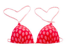 Red bikini top with heart shape Royalty Free Stock Photo