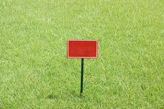 Red billboard in greensward Stock Photo