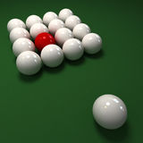 Red billiard ball among cue balls. Billiard game with lots of white balls and a red one Stock Photo