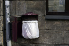 Red bin attached to the wall of the house Royalty Free Stock Photography