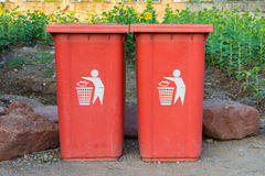 Red bin in the park. stock photos
