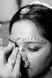 Red Bindi. A Red Bindi is applied to a Hindu brides forehead Stock Photography