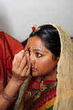 Red Bindi. A Red Bindi is applied to a Hindu brides forehead Royalty Free Stock Photos