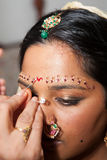 Red Bindi. A Red Bindi is applied to a Hindu brides forehead Stock Photo