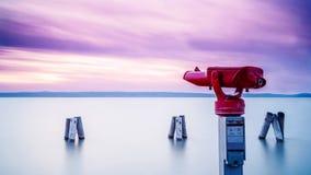 Red binocular on sea shore Stock Image