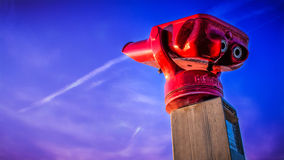 Red binocular on sea shore Stock Photo
