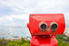 Red binoculars at observation deck Stock Photos