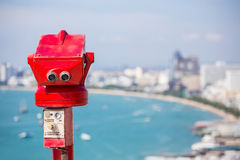 Red binoculars at view point Royalty Free Stock Images