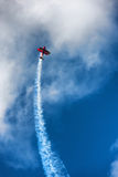 Red biplane aircraft in the blue sky Royalty Free Stock Photography