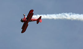 Red Biplane Loop at EAA AirVenture Airshow Royalty Free Stock Image