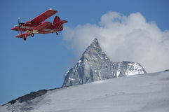 Red biplane over the Matterhorn Royalty Free Stock Photos