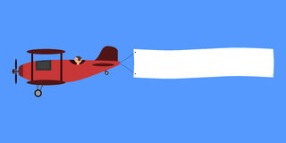 Red biplane with poster. Stock Image