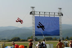 The red biplane  - Slovac air show The big screen Stock Photography