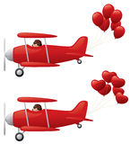 Red biplanes towing balloons. Royalty Free Stock Image