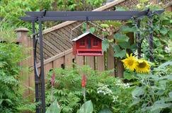 Red bird feeder Stock Photo