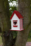 Red bird house. Home-made red bird house waiting for new occupants Stock Photos
