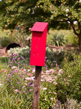 Red bird house for tits royalty free stock photo