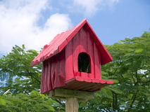 Red birdhouse Stock Photo