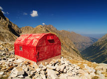 Red bivouac. A red bivouac in a mountain landscape with a deep blue sky Stock Photos