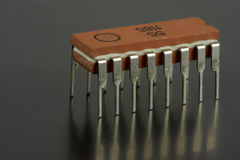 Red on black. Close-up of microchip on black background Stock Images