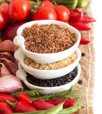 Red, Black And Unpolished Organic Rice And Vegetables Stock Photo