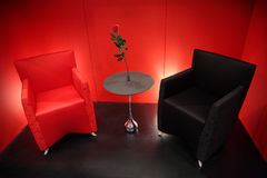 Red and black armchairs in red room Royalty Free Stock Photography
