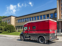 Red and black armored truck Stock Photography