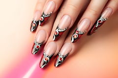 Red and black art design on nails. Stock Image