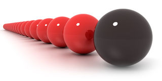 Red and black billiard balls arrangement. Close-up shot on a line of red billiard balls and a black one Stock Photography