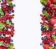 Red and black-blue fruits and berries. Ripe currants, blueberries, strawberries, raspberries, blackberries on white background. Be. Rries at border of image with Stock Photos
