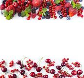 Red and black-blue fruits and berries. Ripe red currants, strawberries, raspberries, blackberries, blueberries, cherries and black. Currants on white background Royalty Free Stock Image