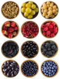 Red, black, blue and yellow food. Fruits and berries in wooden bowl isolated on white. Sweet and juicy berry with copy space for t. Ext. Collage of different Royalty Free Stock Photos