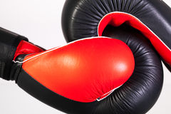 Red and black boxing gloves on a glass table Stock Photography