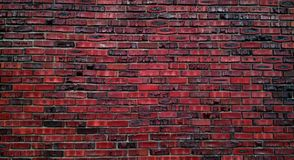 Multicolored brick wall for background. Red, black, and brown exterior brick wall for wallpaper, copy space or architectural feature Royalty Free Stock Photography