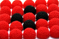 Red and black candy gum drops Royalty Free Stock Photography