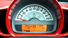 Red and Black Car Speedometer at Neutral Stock Image