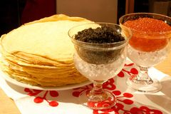Red and Black caviar. With pancakes Stock Photography