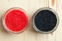 Red and black caviar in bowl Stock Images